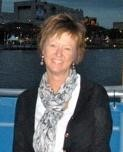 A photo of Hope Leet Dittmeier standing before a river